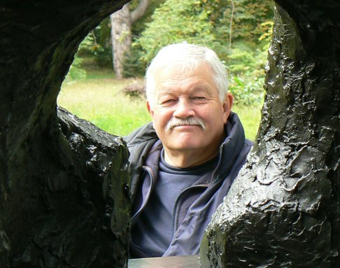 Phil Friend looking through a porthole